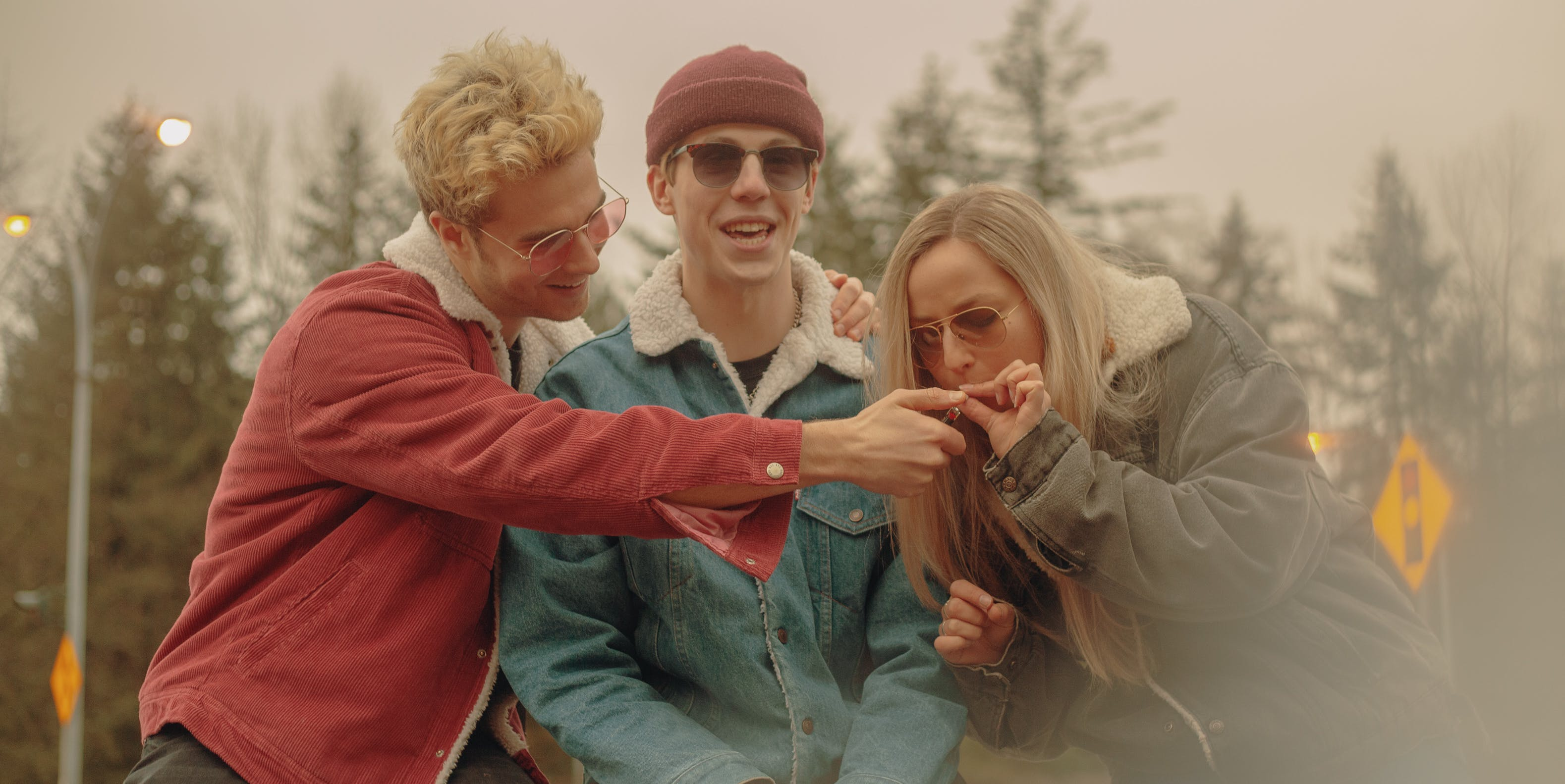 What is Kush? Three people share a joint in front of some trees